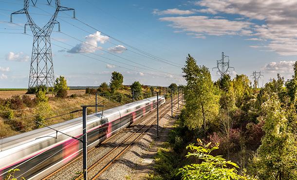 train speeding along the tracks