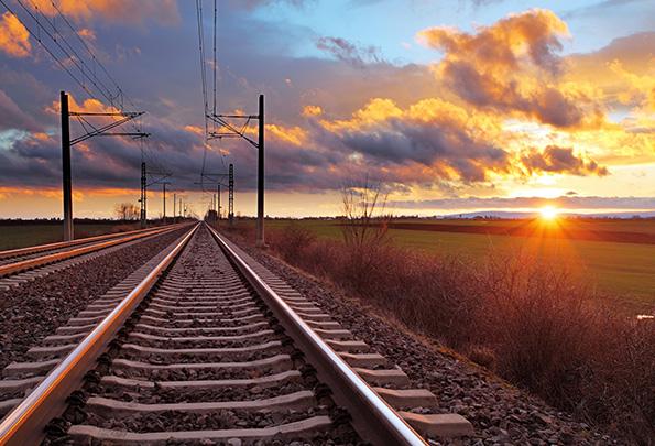 train tracks under an overcast sky